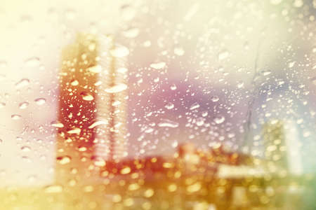 kropla deszczu: double exposure of blurred cityscape and raindrop with color filter