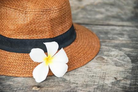 plumeria flower on woven hat , in soft focus