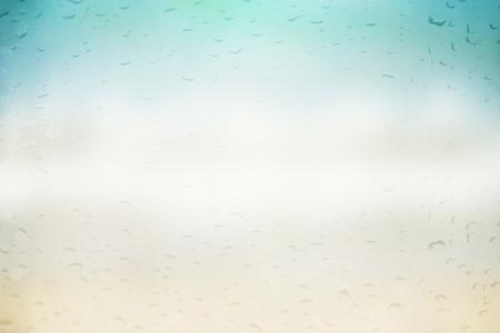 beach rain: blurred rain drops on beach background Stock Photo