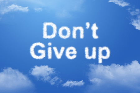 Dont give up cloud text on blue sky