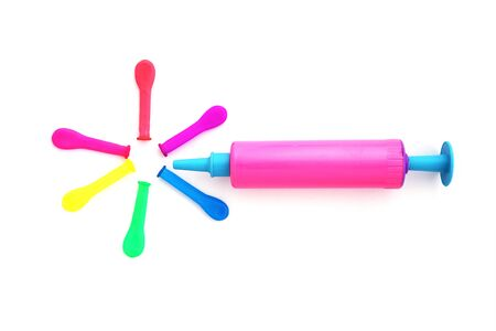 small pink plastic bellows and mulitcolor balloons,kids toy , on white background