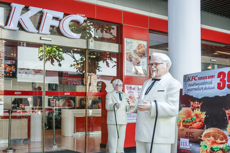 BANGKOK ,THAILAND- August 22 ,2017: Colonel Harland Sanders statue standing in front of Kentacky Fried chicken restaurant (KFC)