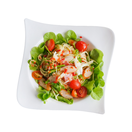 spicy sausage salad on plate isolated on white background with clipping path