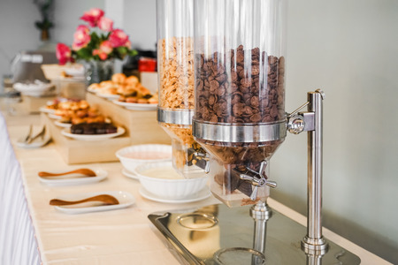 Cereal dispensers for self service breakfast in  hotel  Stock Photo