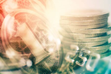 double exposure of coins and one dollar banknote with credit card for business and finance background
