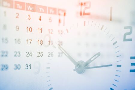 double exposure of analog clock and calendar , time passing concept