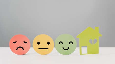 emotion face on circle paper and house for family , happy home, retirement home, quality of life