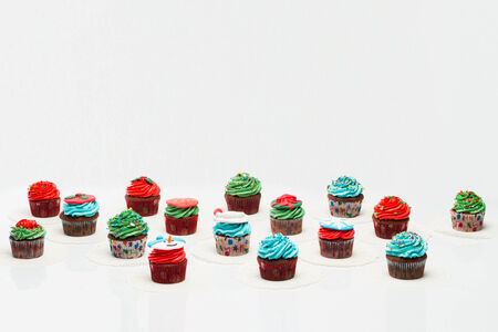 A lot of tasty cupcakes with sprinkles, chocolate. Christmas Concert Stock Photo