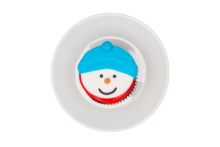 butter icing: Christmas cupcake with butter cream icing. Snowman