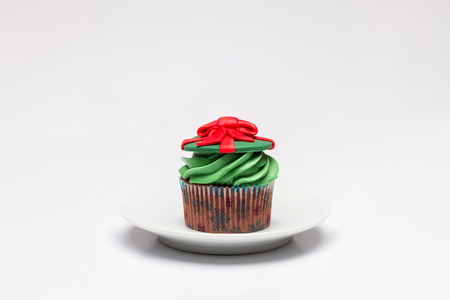 butter icing: Cupcake with butter cream icing.  Stock Photo