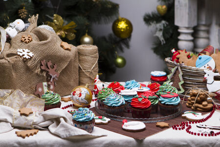 Christmas various gingerbread cookies, cakes, cupcakes. Christmas decorations. Confection photo