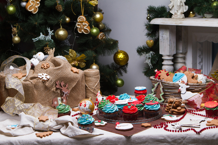 Christmas various gingerbread Christmas decoration with food, cakes, cupcakes, confection. Christmas tree with ornaments. Gingerbread man photo