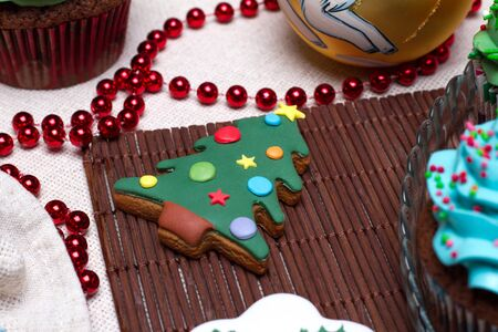 Christmas various gingerbread Christmas decoration with food, cakes, cupcakes, confection. Christmas tree with ornaments. photo