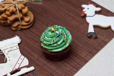 wood molding: Christmas Treats. Cakes, cupcakes, confection. Stock Photo
