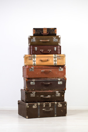 antique suitcase: A large number of old suitcases. Old suitcases stacked in the interior.