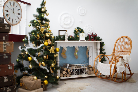 hearth and home: Interior with Christmas decorations. Living room. Christmas tree and fireplace Stock Photo