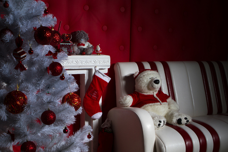 hearthside: Interior with Christmas decorations. Living room. Christmas tree and fireplace Stock Photo