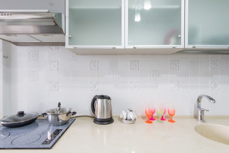 countertops: Kitchen interior closeup  in the frame contains a table, sink and gas stove Stock Photo