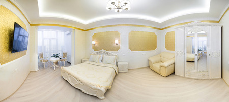 luxuriously: Luxurious bed with cushion in royal bedroom interior. Panorama hotel room in gold tones