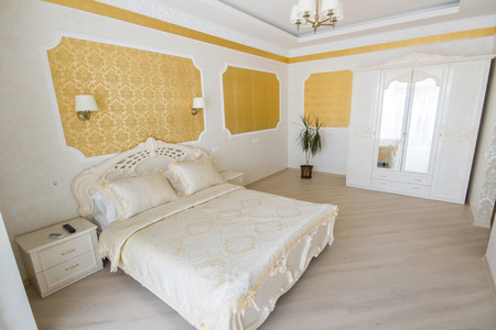 luxury bedroom: interior luxury apartment, comfortable bedroom. Baroque style Stock Photo