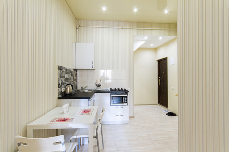 kitchenette: Small kitchen in a studio apartment. The interior is made in bright colors