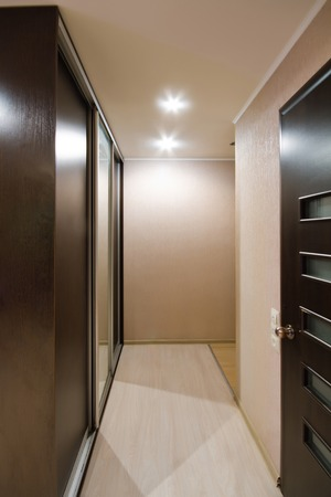 interior lighting: interior corridor with wooden floors and artificial lighting Stock Photo