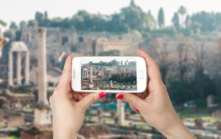 emporium: Travel photo on the phone. Roman Forum in Rome, Italy Stock Photo