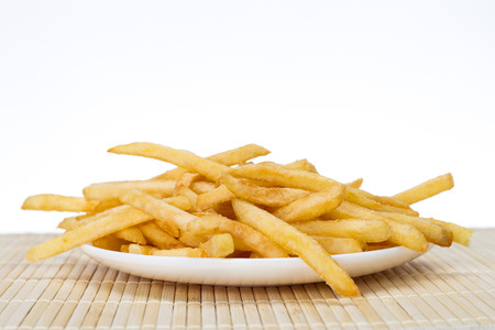 frites: Potatoes fries in a little white paper bag