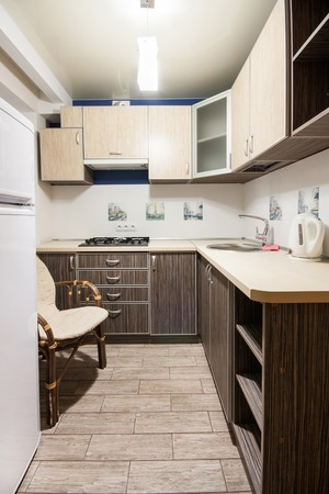 kitchenette: Small kitchenette in a studio, interior lighting
