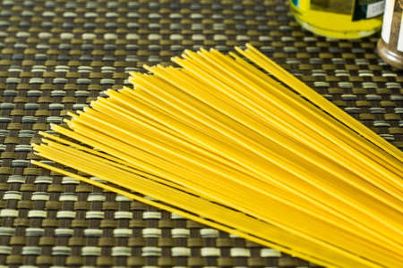 a bunch of pasta with olive oil and herb photo