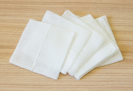 white gauze pads on wooden background 스톡 콘텐츠