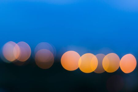 city light: City light blur circle bokeh on blue background