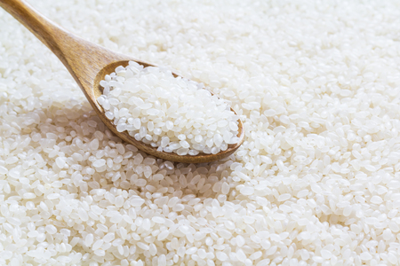 White rice on wooden spoon, japanese rice, short grain rice