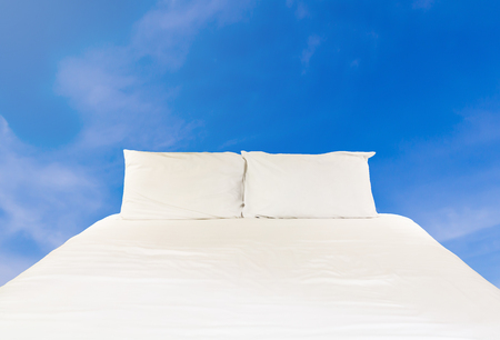 comfortable: Clean bed on blue sky, relaxation and comfortable concept