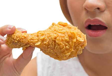Girl holding fried chicken drumstick, fast food, junk food ,fat concept