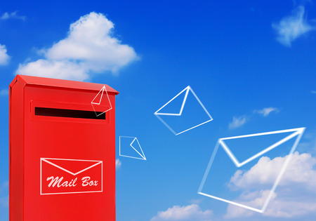 Red mail box and flying letter on blue sky background, post service concept Stok Fotoğraf