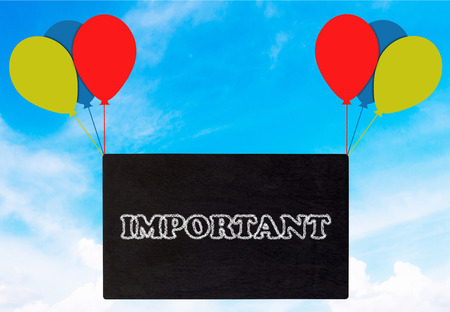 Important announcement, blackboard and balloon on blue sky background Stock Photo