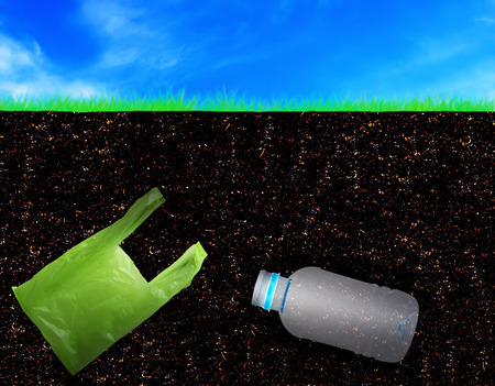 Pollution soil problem concept, bury plastic bag and bottle
