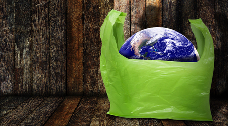 Pollution problem concept, the Earth in plastic bag, Elements of this Image Furnished by NASA