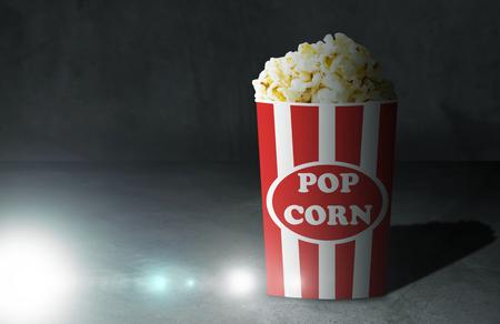 Movie, cinema, entertainment, leisure concept, popcorn and screen lighting Stock Photo