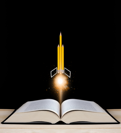 online degree: Education concept, knowledge management, yellow pencil rocket on blackboard background