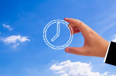 hands  hour: Time management concept, business planning, hand holding cloud clock on blue sky background Stock Photo