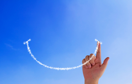 Happiness concept, hand drawing smile cloud on blue sky background