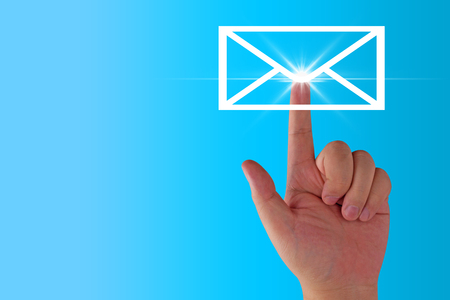 Email concept, hand and envelope icon on blue background