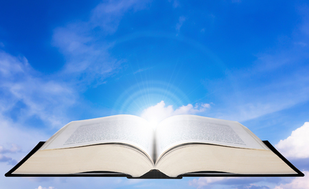 Education concept, knowledge management, open book on blue sky background