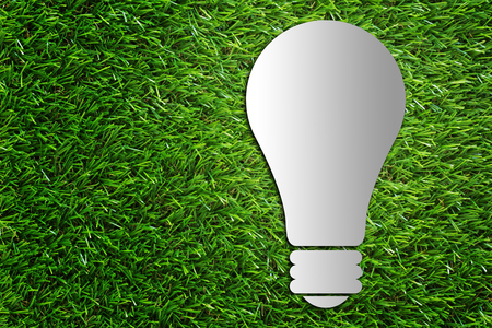 Ecology idea concept, green energy, light bulb on green grass background Stok Fotoğraf