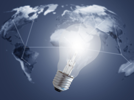 Energy concept, world map and light bulb on blue background Stok Fotoğraf