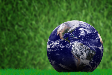 Ecology concept, the earth on green grass background