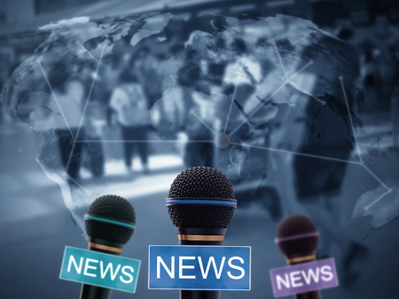 News concept, microphone on blue world map background