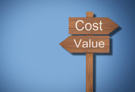 Business financial cost and value concept, wooden sign on blue background Stok Fotoğraf